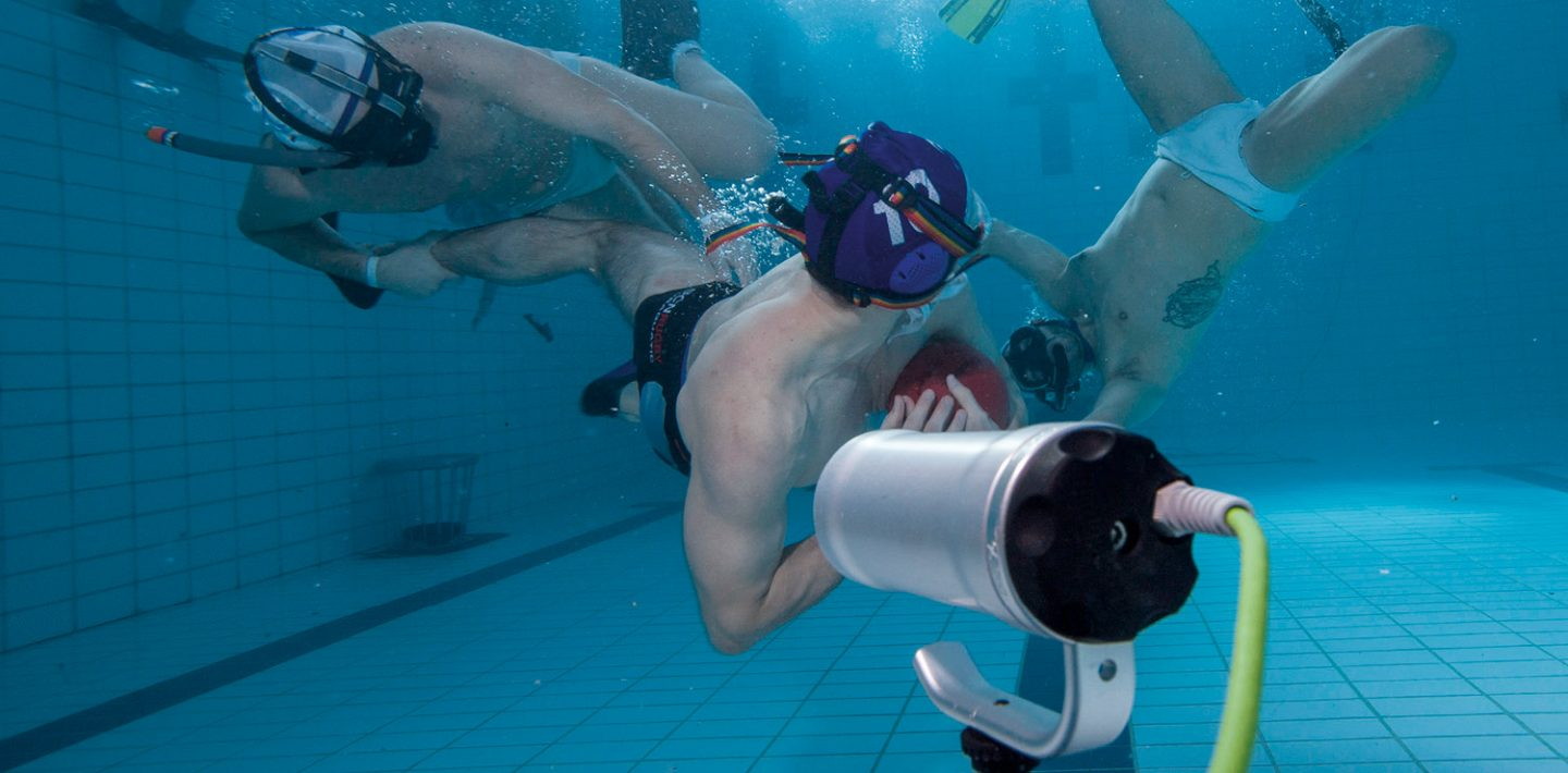 Players are shown playing underwater rugby.