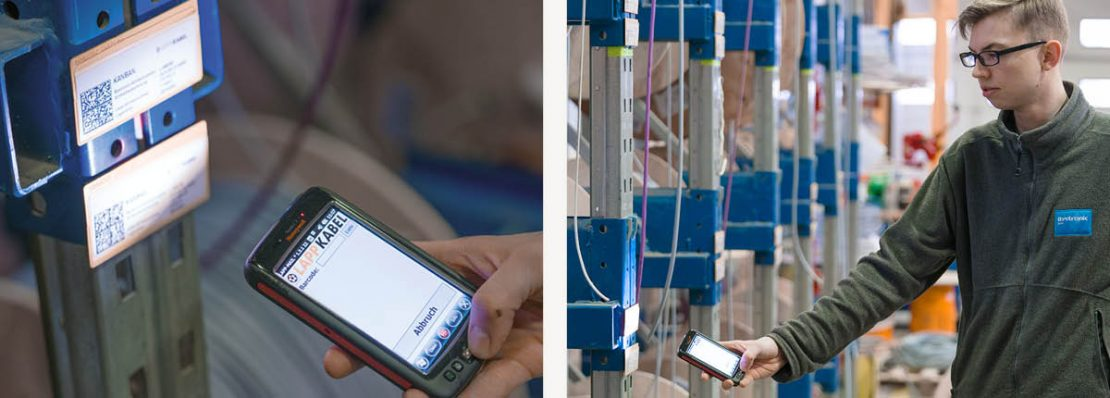 An employee scans an EAN code in order to reorder a cable drum using LAPP's Kanban solutions.