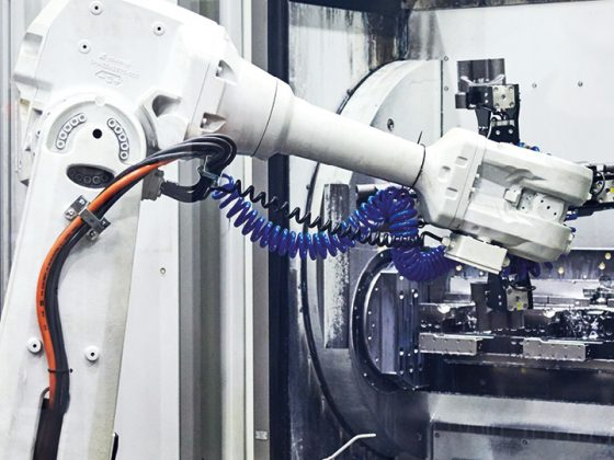 The picture shows a robot with cables from VIVA Forging Company.