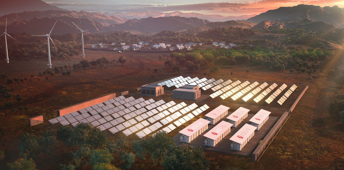 The picture shows a solar park with Azelio modules for storing thermal energy, wind turbines and a village in front of mountains.