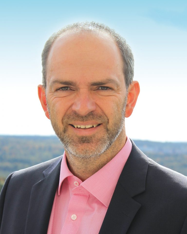 The picture shows a portrait of Martin Tepe, Head of Corporate IT.