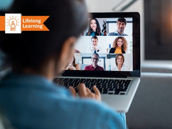 In the picture you can see a woman at the laptop during a video conference.