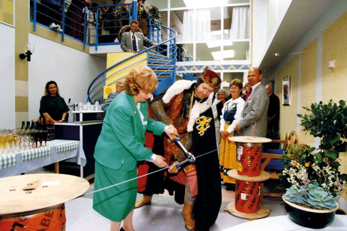 On the picture you can see Ursula Ida Lapp cutting the cable at the opening of the new Miltronic Sweden building.