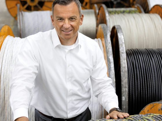The picture shows Chief Operating Officer LAPP LA EMEA Boris Katic in front of cable drums.
