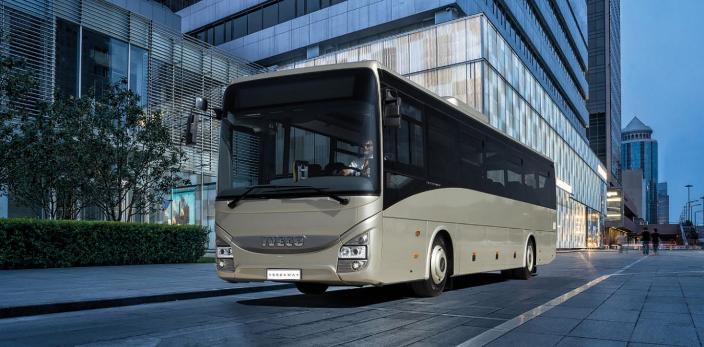 The picture shows a bus from IVECO Czech Republic in front of a building.