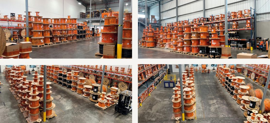 The picture shows LAPP Panamá's 1,300 square meter warehouse with shelves full of cable drums.