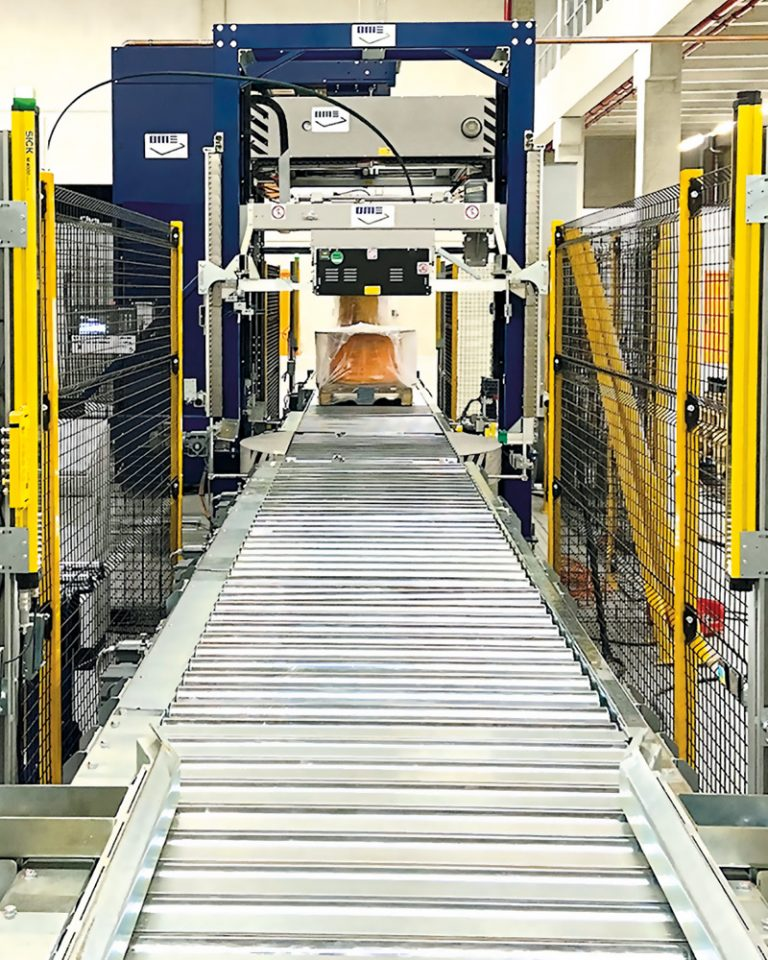 The picture shows a packaging line from Officina Meccanica Sestese (OMS Group).