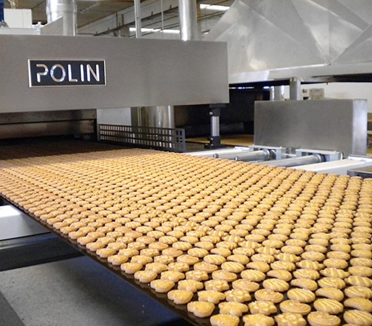The picture shows an assembly line covered with biscuits in biscuit production.