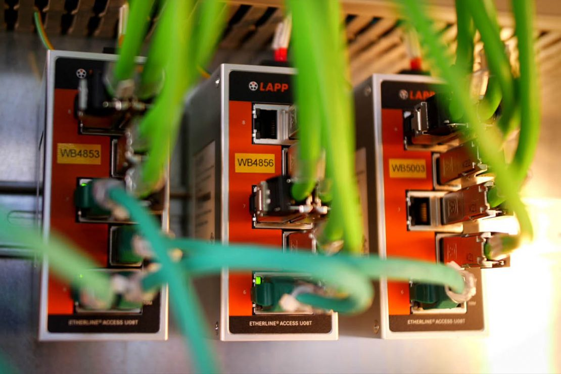The picture shows three ETHERLINE® ACCESS switches from LAPP in use in a biscuit production facility.